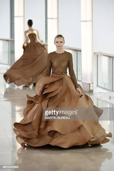 A model presents a creation by Stephane Rolland during the 2015 Haute Couture SpringSummer collection fashion show on January 27 2015 in Paris AFP...