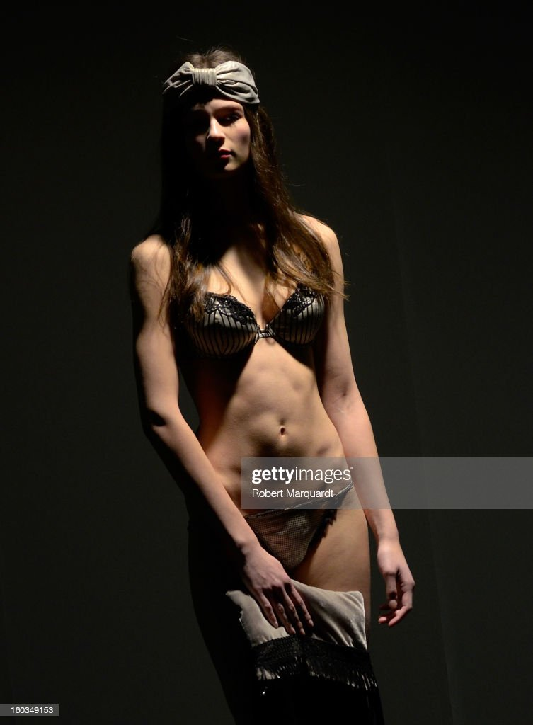 A model presents a creation by TCN during the 080 Barcelona 'Autumn-Winter 2013-2014' fashion week in Barcelona on January 29, 2013 in Barcelona, Spain.