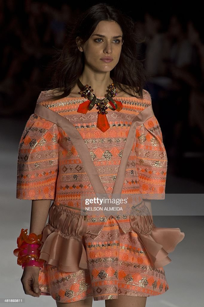 A model presents a creation by Triton during the 2015 Summer collections of the Sao Paulo Fashion Week in Sao Paulo Brazil on April 1 2014 AFP PHOTO...