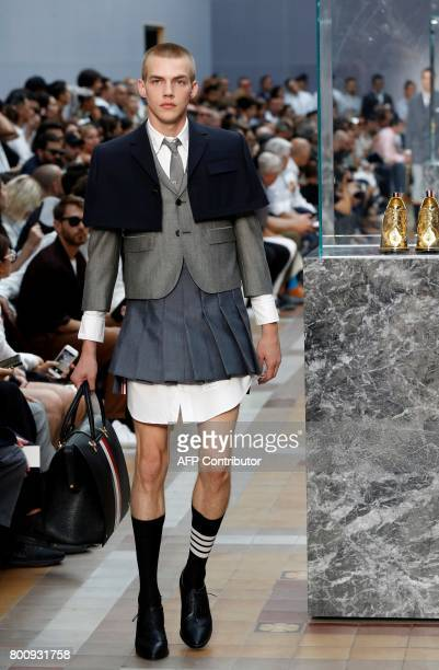 A model presents a creation by US designer Thom Browne during the Men's Fashion Week for the Spring and Summer 2018 collection in Paris on June 25...