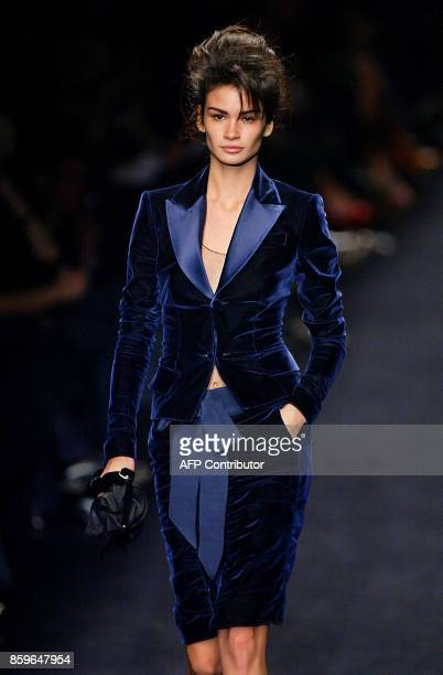 A model presents a creation by US designer Tom Ford for Yves Saint Laurent Rive Gauche 11 March 2002 in Paris during the AutumnWinter 2002/2003...