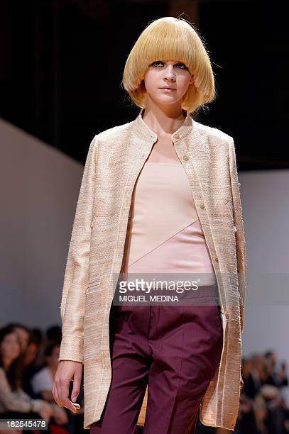 A model presents a creation by Veronique Branquinho during the 2014 Spring/Summer readytowear collection fashion show on September 30 2013 in Paris...