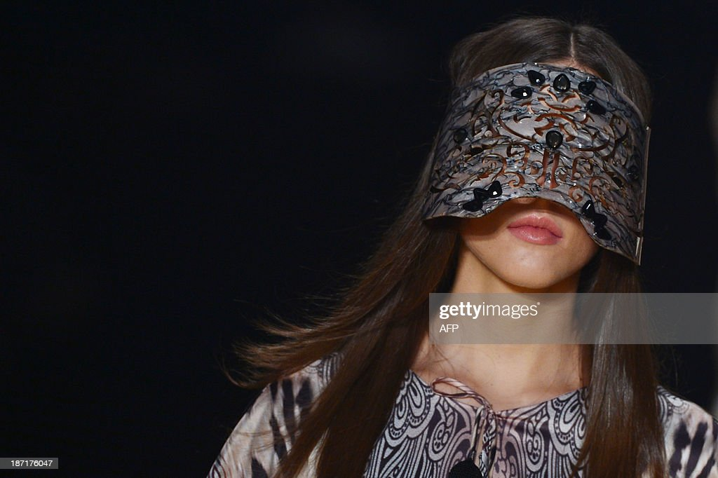 A model presents a creation by Victor Dzenk during the 2014 Winter collection of Fashion Rio in Rio de Janeiro, Brazil, on November 6, 2013