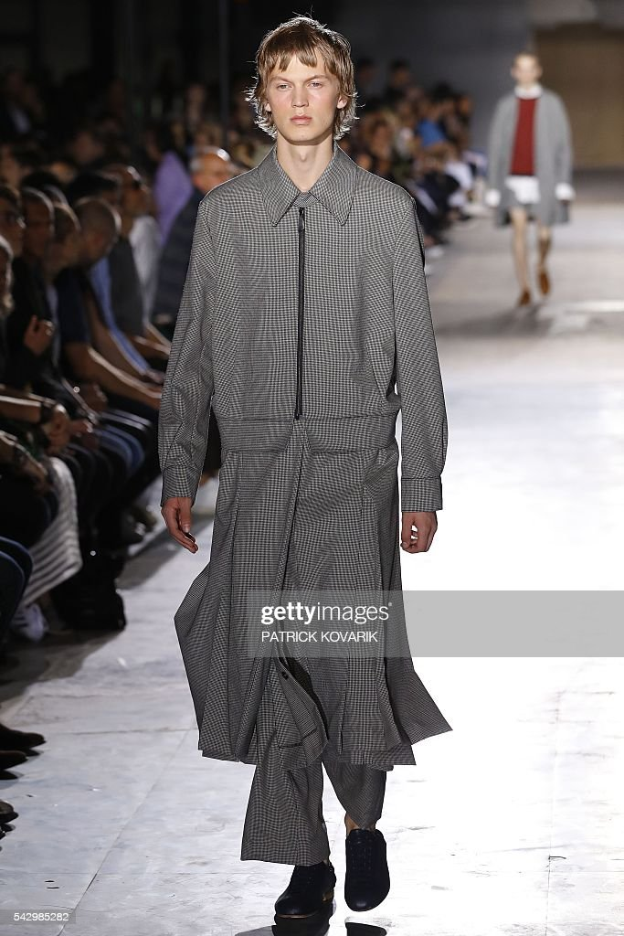 A model presents a creation by Wooyoungmi during the men Spring summer 2017 collection fashion show on June 25, 2016 in Paris. / AFP / PATRICK