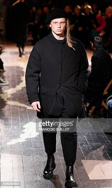 A model presents a creation by Yohji Yamamoto during the men's Fashion Week for the 20162017 Fall/Winter collection in Paris on January 21 2016 / AFP...