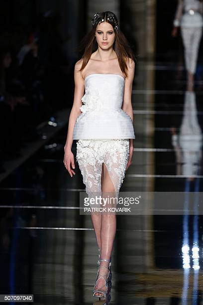 A model presents a creation by Zuhair Murad during the 2016 spring/summer Haute Couture collection on January 27 2016 in Paris AFP PHOTO / PATRICK...
