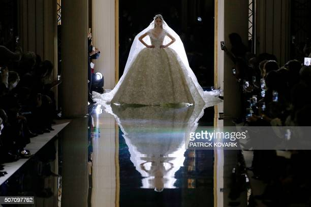 TOPSHOT A model presents a creation by Zuhair Murad during the 2016 spring/summer Haute Couture collection on January 27 2016 in Paris / AFP /...