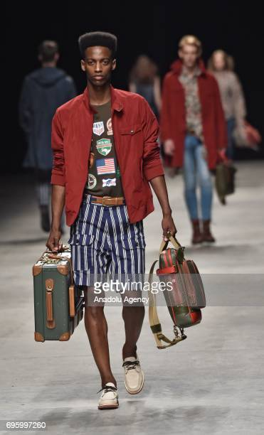 A model presents a creation during Hunting World Fashion Parade within 92nd Pitti Immagine Uomo which is one of the worlds most important platforms...