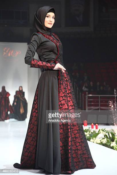 A model presents a creation during Islamic Fashion Week in Grozny capital city of the Chechen Republic Russia on December 08 2014