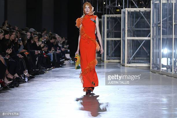 A model presents a creation during the Christopher Kane catwalk show at the Autumn / Winter 2016 London Fashion Week in London on February 22 2016 /...