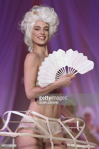 TOPSHOT A model presents a creation during the French Lingerie Show 'Lingerie Mon Amour' by Lingerie Francaise in Paris on January 22 2017 The French...