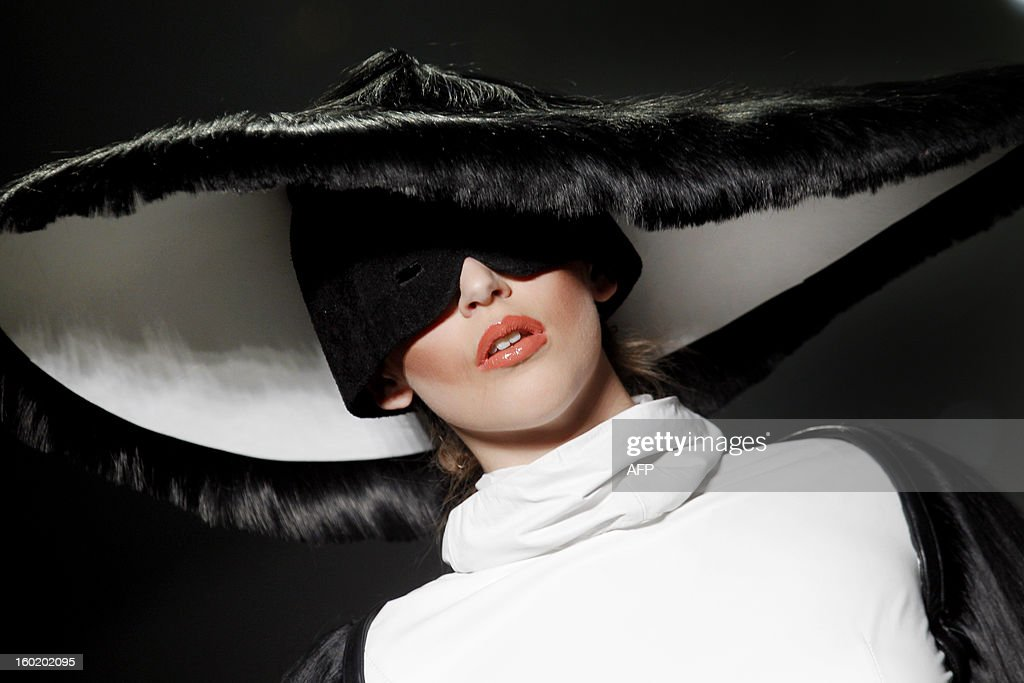 A model presents a creation during the L'Oreal Hairshow as part of the 18th edition of the Amsterdam Fashion Week in Amsterdam, on January 27, 2013. The Fashion Week runs from 18 to 27 January.
