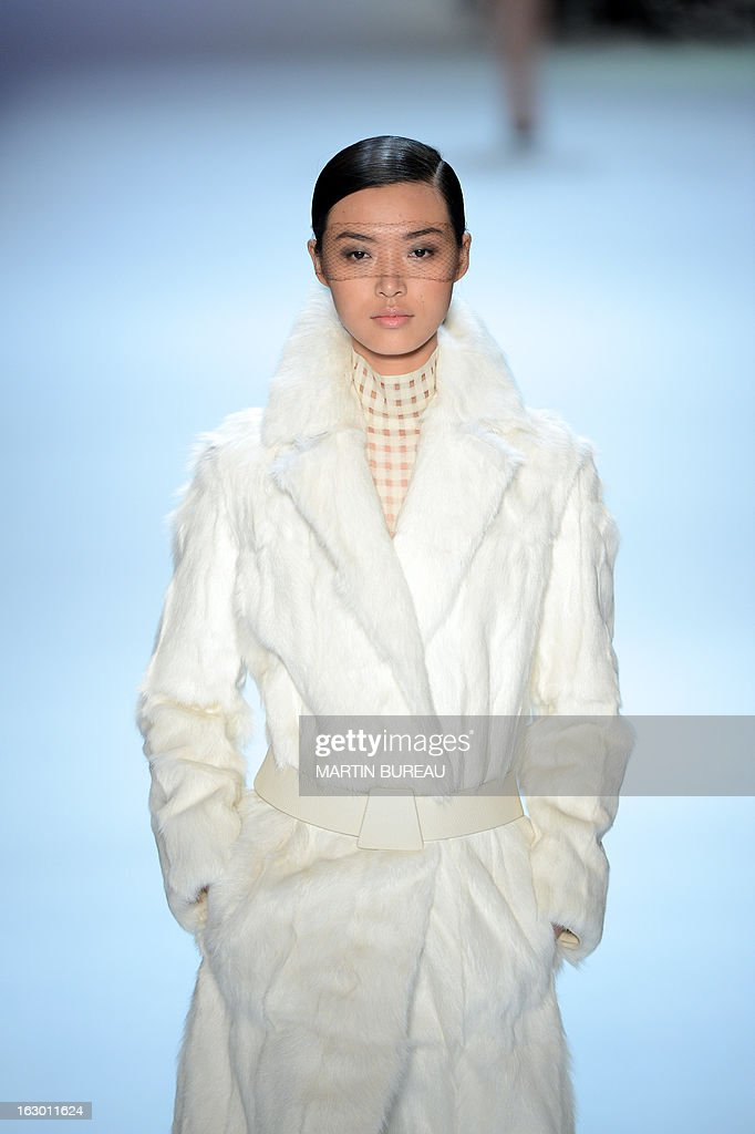 A model presents a creation for Akris during the Fall/Winter 2013-2014 ready-to-wear collection show, on March 3, 2013 in Paris.