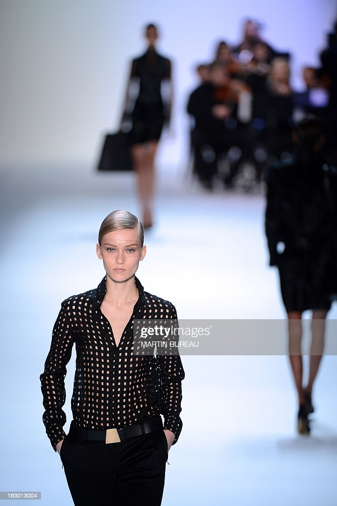 A model presents a creation for Akris during the Fall/Winter 2013-2014 ready-to-wear collection show, on March 3, 2013 in Paris. AFP PHOTO/MARTIN BUREAU