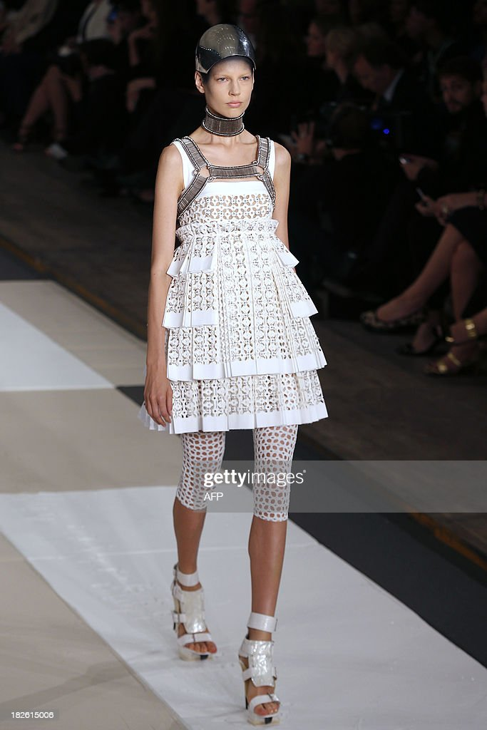 A model presents a creation for Alexander McQueen during the 2014 Spring/Summer ready-to-wear collection fashion show, on October 1, 2013 in Paris.