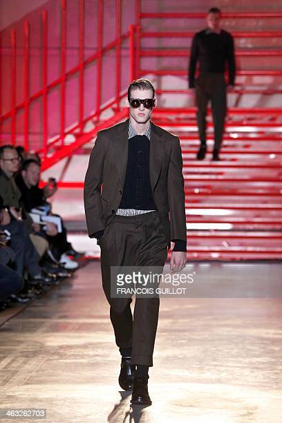 A model presents a creation for Cerruti 1881 during the Fall/Winter 20142015 men's fashion show in Paris on January 17 2014 AFP PHOTO FRANCOIS GUILLOT