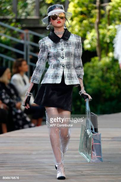 A model presents a creation for Chanel during the women's 2018 Spring/Summer readytowear collection fashion show in Paris on October 3 2017 / AFP...