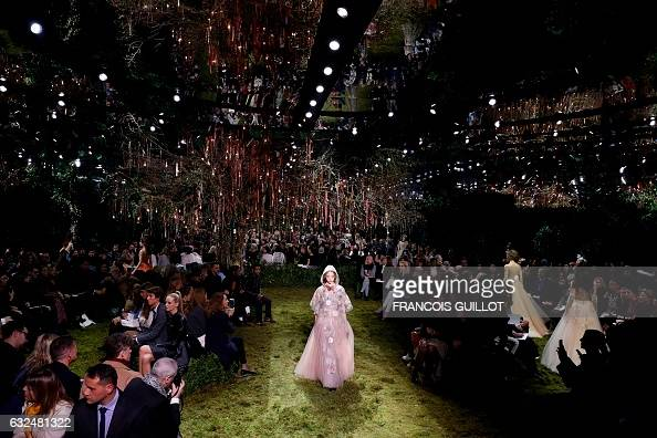 TOPSHOT A model presents a creation for Christian Dior during the 2017 spring/summer Haute Couture collection on January 23 2017 in Paris / AFP /...