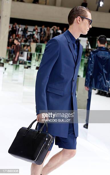 A model presents a creation for Christian Dior during the men's spring/summer 2014 readytowear fashion show on June 29 2013 in Paris AFP PHOTO /...