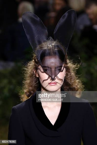 TOPSHOT A model presents a creation for Christian Dior show during the 2017 spring/summer Haute Couture collection on January 23 2017 in Paris / AFP...