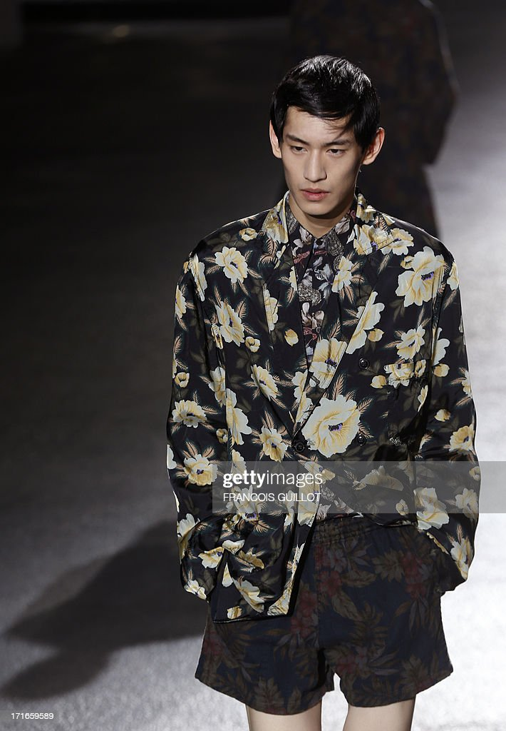 A model presents a creation for Dries Van Noten fashion house during the men's ready-to-wear fashion shows on June 27, 2013 in Paris.