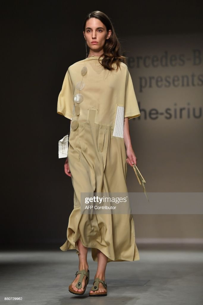 model-presents-a-creation-for-fashion-brand-thesirius-by-south-korean-picture-id850729962
