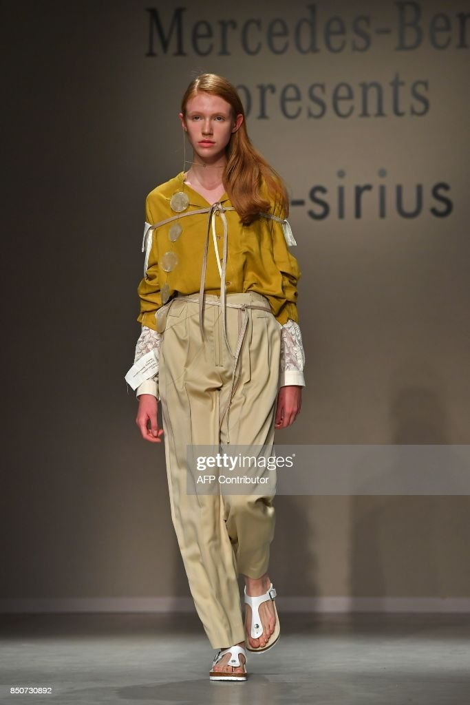 model-presents-a-creation-for-fashion-brand-thesirius-by-south-korean-picture-id850730892