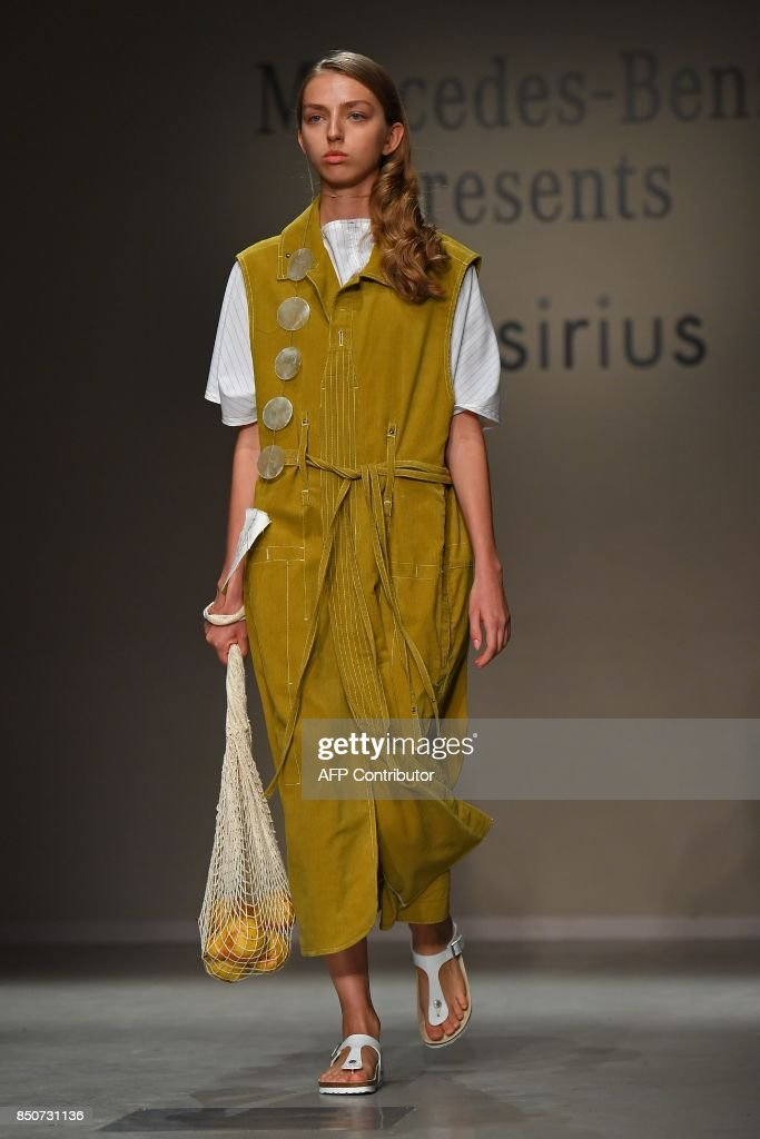model-presents-a-creation-for-fashion-brand-thesirius-by-south-korean-picture-id850731136