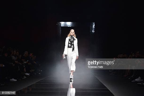 TOPSHOT A model presents a creation for fashion house Anteprima during the Autumn / Winter 2016 Milan Fashion Week on February 25 2016 AFP PHOTO /...