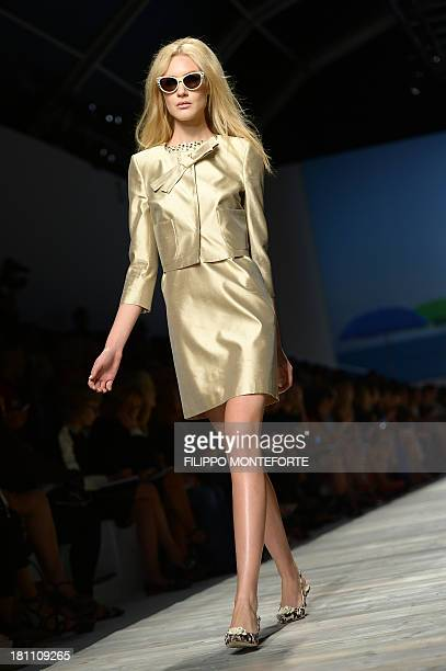 A model presents a creation for fashion house Blugirl as part of the spring/summer 2014 readytowear collections during the fashion week in Milan on...