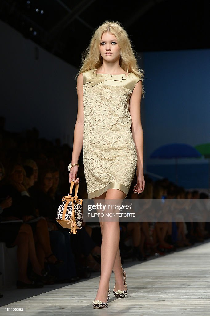 A model presents a creation for fashion house Blugirl as part of the spring/summer 2014 ready-to-wear collections during the fashion week in Milan on September 19, 2013.