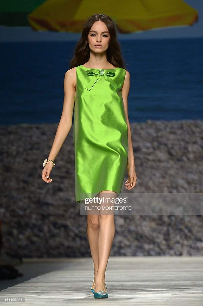 A model presents a creation for fashion house Blugirl as part of the spring/summer 2014 ready-to-wear collections during the fashion week in Milan on September 19, 2013. AFP PHOTO / FILIPPO MONTEFORTE