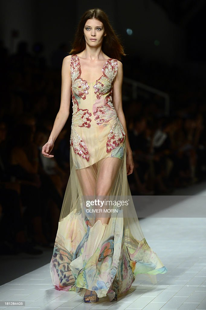 A model presents a creation for fashion house Blumarine as part of the spring/summer 2014 ready-to-wear collections during the fashion week in Milan on September 20, 2013.