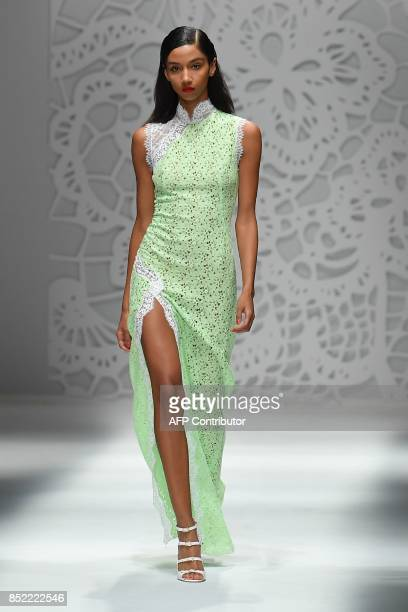 A model presents a creation for fashion house Blumarine during the Women's Spring/Summer 2018 fashion shows in Milan on September 23 2017 / AFP PHOTO...