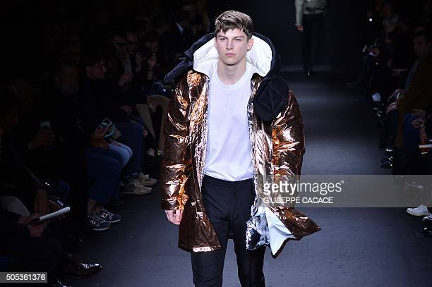 A model presents a creation for fashion house Calvin Klein during the Men Fall Winter 2016 / 2017 collection shows at the Milan's Fashion Week on...
