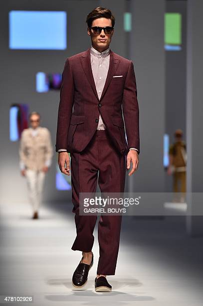 A model presents a creation for fashion house Canali at the Men SpringSummer 2016 Milan's Fashion Week on June 22 2015 AFP PHOTO / GABRIEL BOUYS