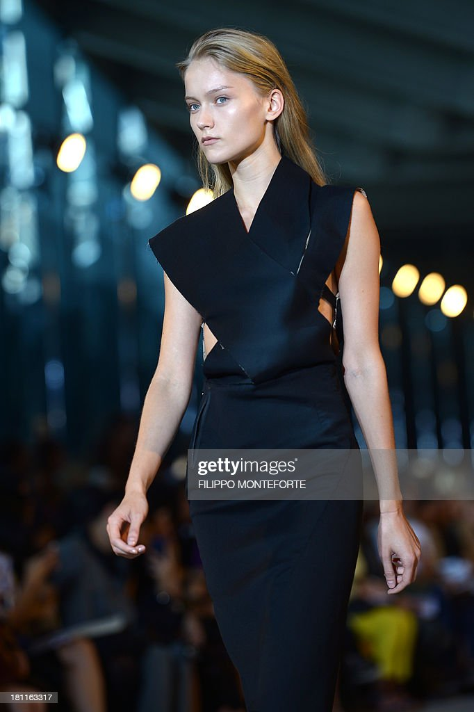 A model presents a creation for fashion house Costume National as part of the spring/summer 2014 ready-to-wear collections during the fashion week in Milan on September 19, 2013. AFP PHOTO / FILIPPO MONTEFORTE