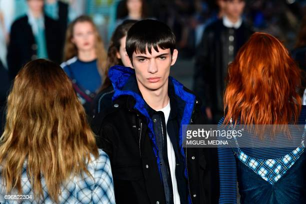 A model presents a creation for fashion house Diesel Black Gold during the Men's Spring/Summer 2018 fashion shows in Milan on June 17 2017 / AFP...