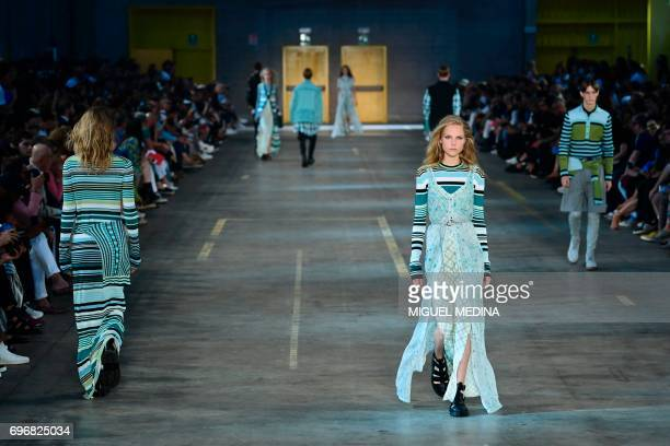 TOPSHOT A model presents a creation for fashion house Diesel Black Gold during the Men's Spring/Summer 2018 fashion shows in Milan on June 17 2017 /...