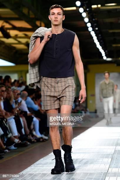A model presents a creation for fashion house Dirk Bikkembergs during the Men's Spring/Summer 2018 fashion shows in Milan on June 18 2017 / AFP PHOTO...