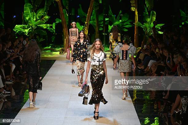 A model presents a creation for fashion house Dolce Gabbana during the 2017 Women's Spring / Summer collections shows at Milan Fashion Week on...