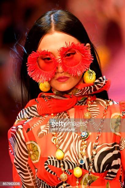 A model presents a creation for fashion house Dolce Gabbana during the Women's Spring/Summer 2018 fashion shows in Milan on September 24 2017 / AFP...
