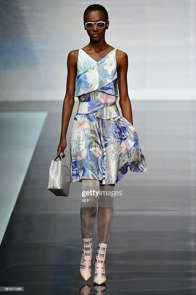 A model presents a creation for fashion house Emporio Armani as part of the spring/summer 2014 ready-to-wear collections during the fashion week in Milan on September 20, 2013.