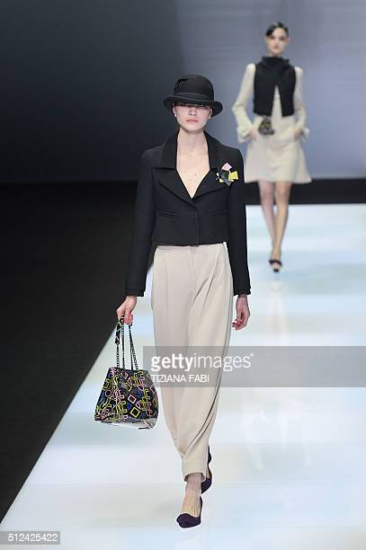 A model presents a creation for fashion house Emporio Armani during the Autumn / Winter 2016 Milan Fashion Week on February 26 2016 AFP PHOTO /...