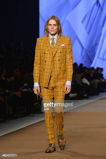 A model presents a creation for fashion house Etro as part of Autumn/Winter 2014 Milan Collections during the Men's fashion week on January 13 2014...