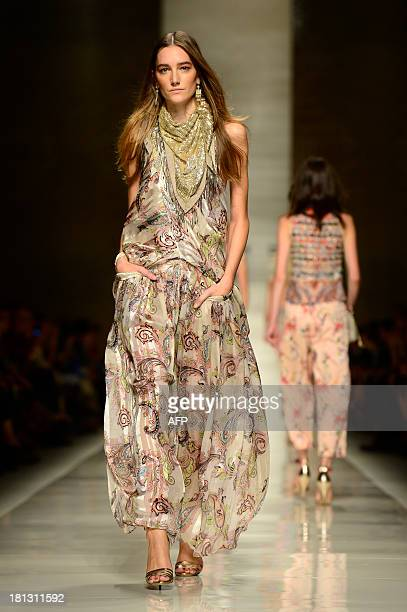 A model presents a creation for fashion house Etro as part of the spring/summer 2014 readytowear collections during the fashion week in Milan on...
