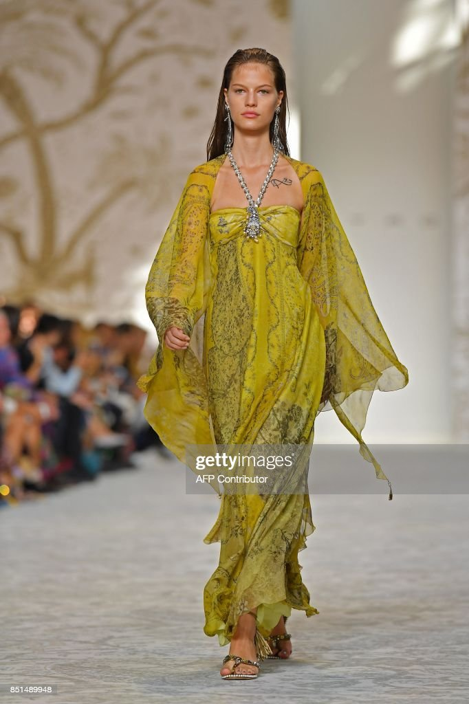 model-presents-a-creation-for-fashion-house-etro-during-the-womens-picture-id851489948