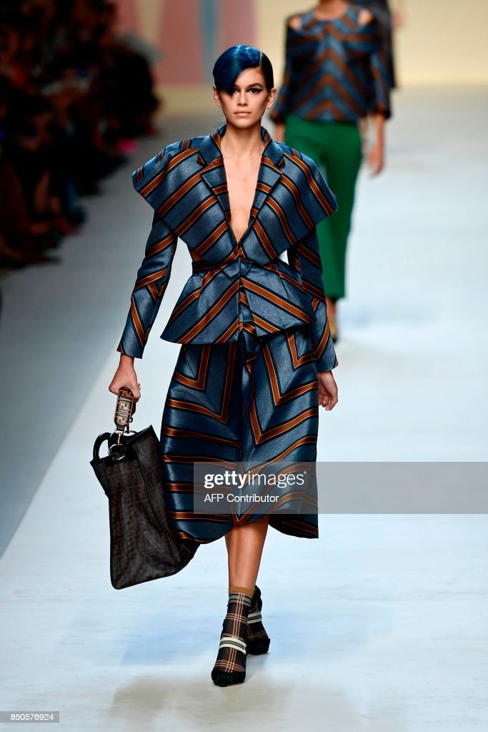 model-presents-a-creation-for-fashion-house-fendi-during-the-womens-picture-id850576924