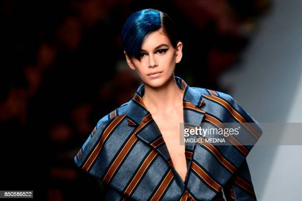 A model presents a creation for fashion house Fendi during the Women's Spring/Summer 2018 fashion shows in Milan on September 21 2017 / AFP PHOTO /...
