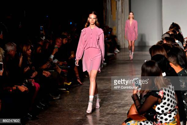 A model presents a creation for fashion house Francesco Scognamiglio during the Women's Spring/Summer 2018 fashion shows in Milan on September 20...